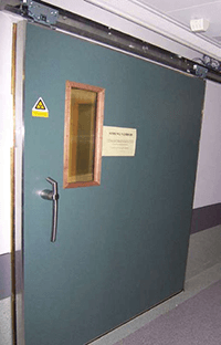 Shielding faraday cage sliding door